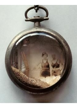 """an old broken pocket watch into a shadow box...stealing this exact idea for the """"swimsuit suite""""!"""