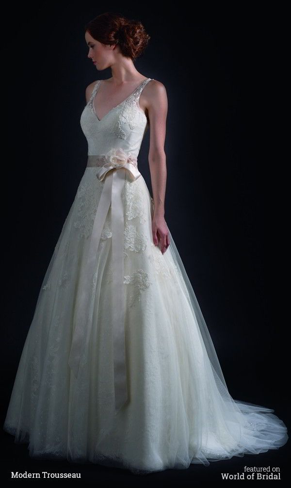 An elegant French lace gown with an A-line skirt and V-neckline. The French Aloncon lace appliques are embroidered onto a tulle skirt.