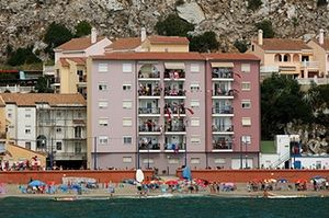 Gibraltar protests: People wave British and Gibraltar flags on the sea wall and their apartment
