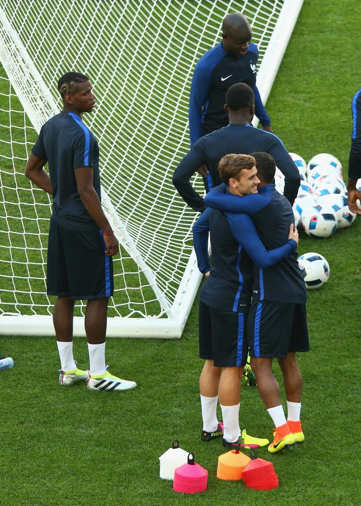 Patrice Evra and Antoine Griezmann of France greet each other during a training session ahead the UEFA EURO 2016 Group A match between France and Albania at Stade Velodrome on June 14, 2016 in Marseille, France.