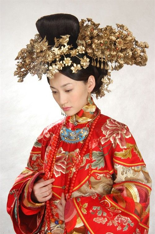 Cheongsam with traditional Chinese head-dress