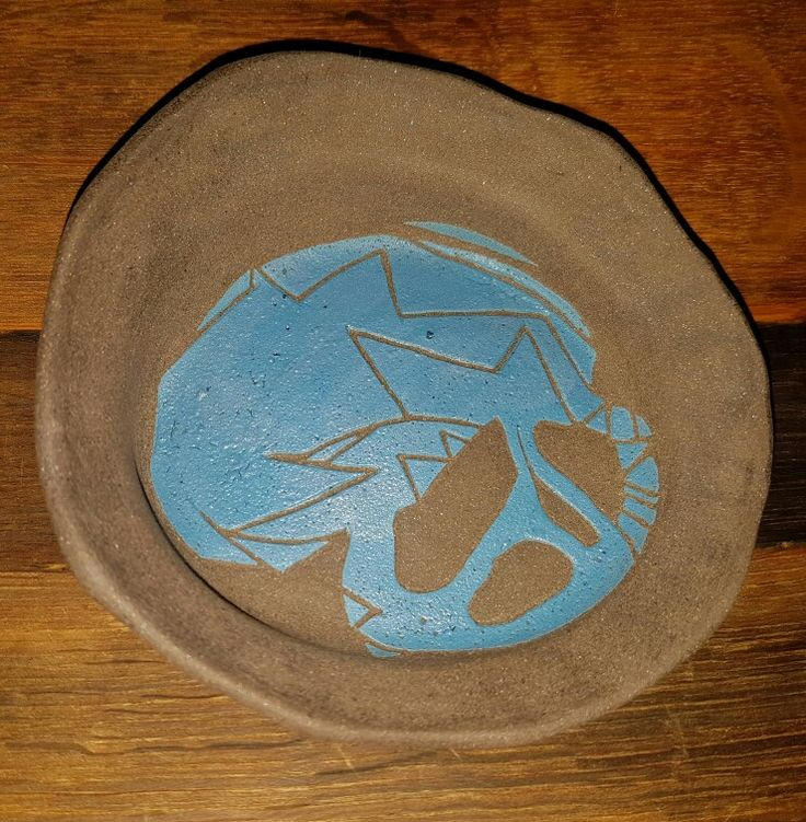 Trick or Treat: Blue underglaze sgraffito on black clay