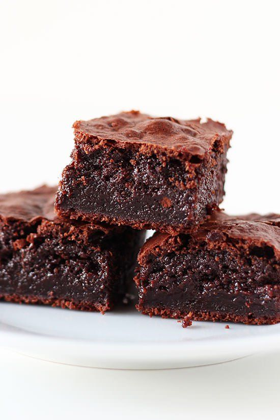 Coconut Oil Brownies are ridiculously moist, fudgy, tall, and rich, with just a hint of coconut throughout. Every bite is pure chocolate heaven!