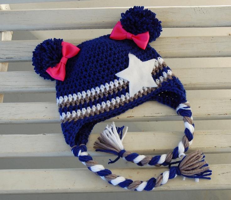 Dallas Cowboy Pom Pom Hat with pink bows.