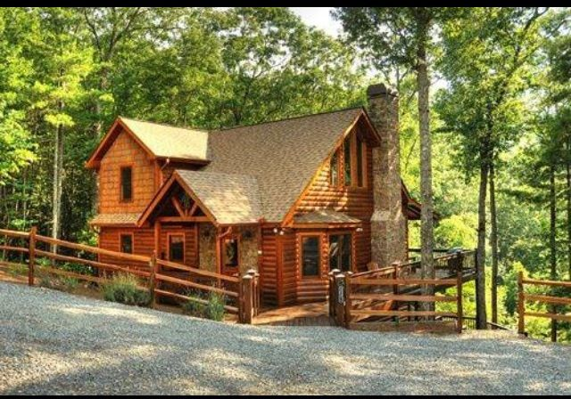 Adorable login cabin back in the woods.