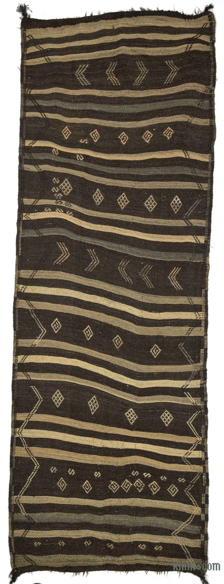 Vintage striped kilim rug hand-woven in Central Anatolia, Turkey in 1960's. This tribal rug is in very good condition. It is perfect for both bohemian and contemporary settings.