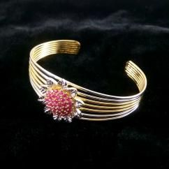 Sun Flower Ruby Gold And Silver Plated Adjustable Bracelet Bangle *Beautifully sun flower filled with ruby, well hand crafted bracelet bangle *Sparkles like real gold bracelet bangle *High quality RUBY are used *Free size - fits every hand *Gold plated with RHODIUM POLISH bracelet bangle   ₹750.00 INR  http://crazyberry.in/online-shopping/artificial-imitation-fashion-jewellery/sunflower-ruby-gold-and-silver-plated-adjustable-bracelet-bangle