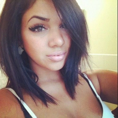 Angled bob; longer in the front with sharp ends giving it an edgy look, long bangs parted to the side, lightly layered with minimal volume not sure if my hairs texture would work with this cut like the pictured girl...