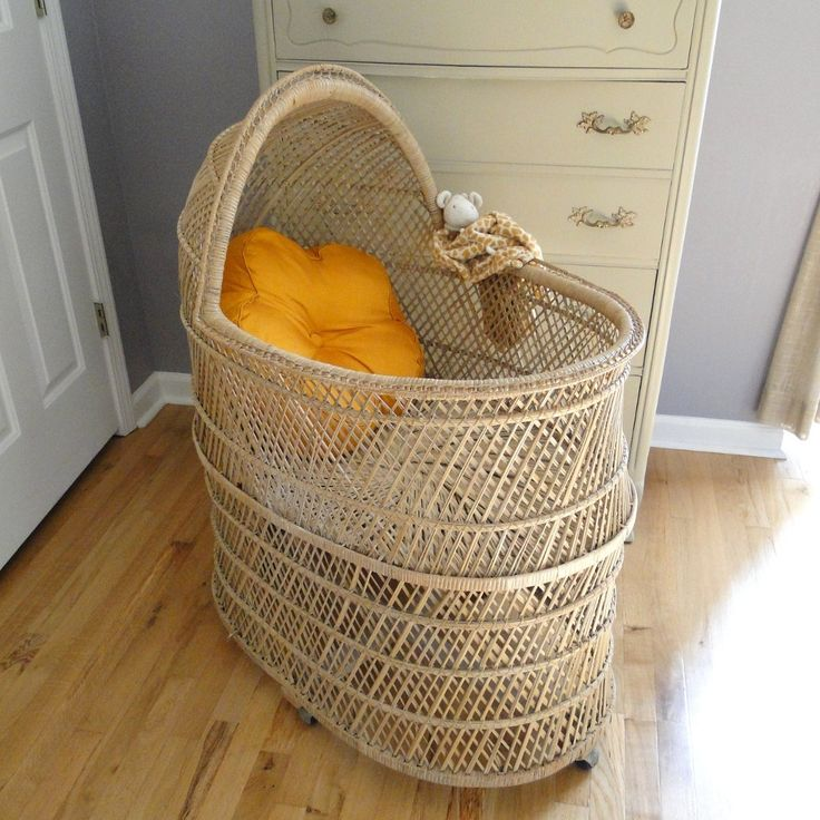 Vintage Baby Bassinet Baby Rattan Cradle Bohemian Baby Chic Rolling Infant Bassinet Eclectic Natural Buri Basket Nursery Bassinet Cradle. $195.00, via Etsy.