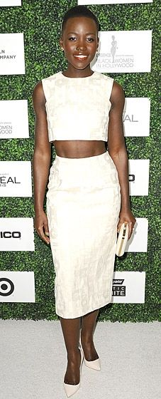 Lupita Nyong'o shows off her toned tummy in a crop top and skirt by Giambattista Valli at the Essence Black Women in Hollywood event