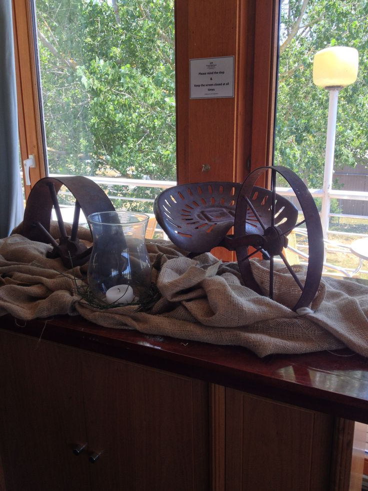 sideboard still life of old rustic farm pieces