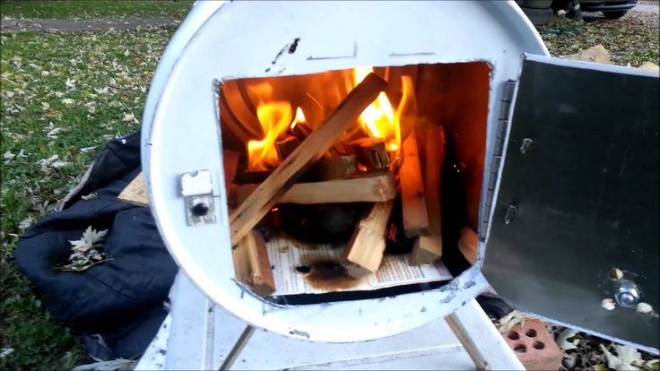 A small woodstove made from 2, 5 gallon metal cans, no power tools or welding needed. Wedge the upper shelf (baffle) inside back from the door about 6 inches at least to avoid smoke coming out when the door is opened, again this is NOT a stove that should be left unattended just something to make and store away with some fire resistant material to go under and around, use the second can to frame in the space of an open window, put a hole in it and run your pipe outside
