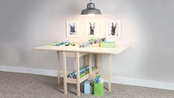 This jack-of-all-trades table serves up a lot of versatility. Equipped with a pivoting leg on each side to support the hinged drop-down leaves, it offers three possible configurations. Placed against a wall with both leaves down, it's a small entryway table, display table or serving table.