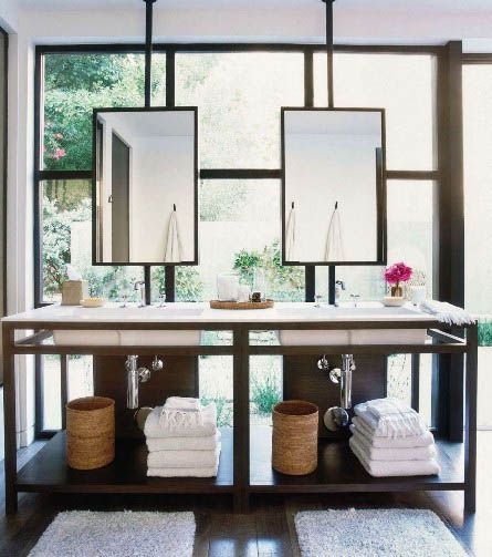 Modern Chic Bathroom with Beautiful mirrors on window above the bathroom sinks, great idea when there is not a solid wall.