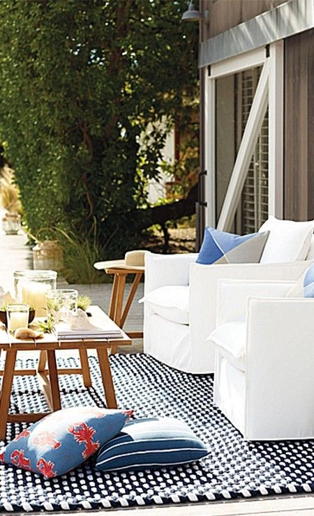 Stunning outdoor deck - white chairs and wooden table