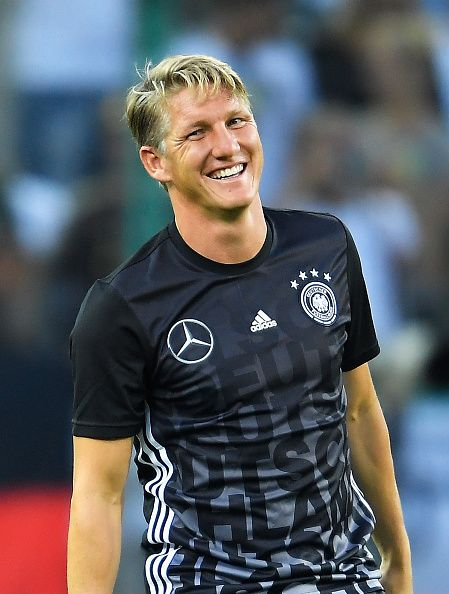 Bastian Schweinsteiger of Germany smiles in the warm up prior to the International Friendly match between Germany and Finland at BorussiaPark on...