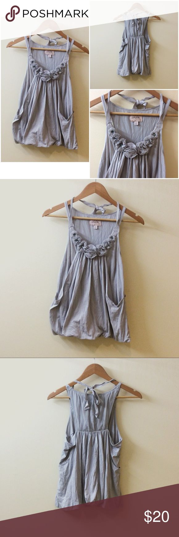 """Deletta, Anthropologie Flower Embellished Tank Beautiful bubble top with flower embellishments along the neckline and a ribbon halter top closure. This cute top looks great with a cute skirt or skinny jeans.  Length: 22"""" Armpit to armpit: 16""""  ALL ITEMS COME FROM A SMOKE AND PET FREE HOME. Anthropologie Tops Blouses"""
