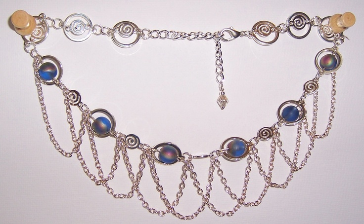 This necklace is elegant with the draping chains, spiral connectors, blue AB glass beads inside the silver circles. The picture does not do it justice. $65