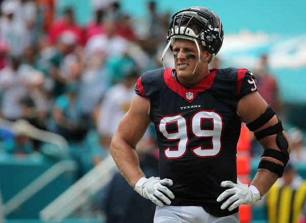 J.J. Watt Photos Photos - J.J. Watt #99 of the Houston Texans looks on during a game against the Miami Dolphins at Sun Life Stadium on October 25, 2015 in Miami Gardens, Florida. - Houston Texans v Miami Dolphins