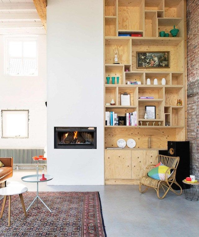 Plywood shelves in a fabulous Dutch home in an old tannery