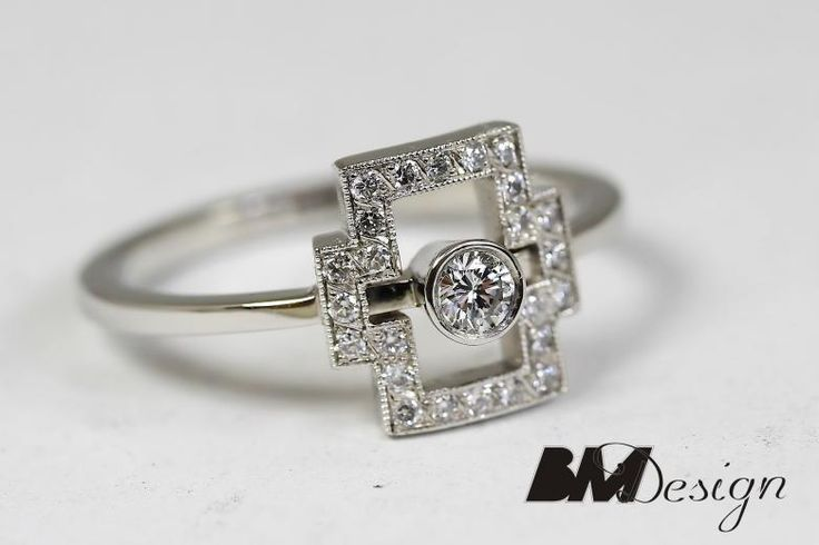 Platynowy pierścionek z diamentami. Projekt i wykonanie BM Design.