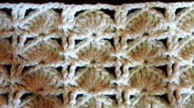 The peacock stitch consists of triple crochet arches, offset by single crochet and chain stitches. It's a relatively easy stitch to make...