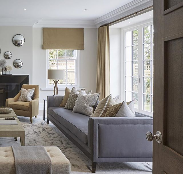 In this showhome the developer requested slightly more colour so we used a golden hue for the curtains and some of the upholstery, art and cushions combined with our signature grey. It also helped warm up the room