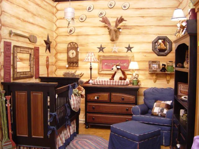 This is my favorite baby room idea so far! I love the stuffed moose head and the little mirror above the changing room! I will totally be using some of these ideas for our cabin themed room!
