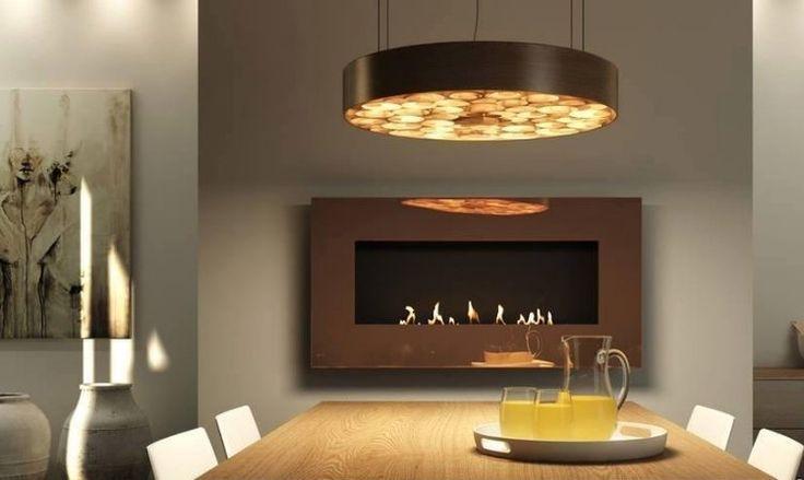 cheminée bio-éthanol et suspension design dans la salle à manger