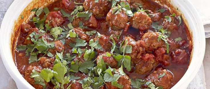 We know you love this classic olive magazine recipe - it's been one of our most popular recipes for years! Gorgeous little lamb meatballs, sitting in a rich tomato sauce and served with buttery coriander and parsley couscous.