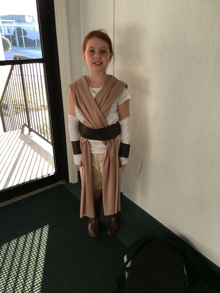 DIY no-sew Rey Star Wars Costume using long fabric pieces draped over shoulders, and belt made from leather fabric all secured with self-stick velcro :)