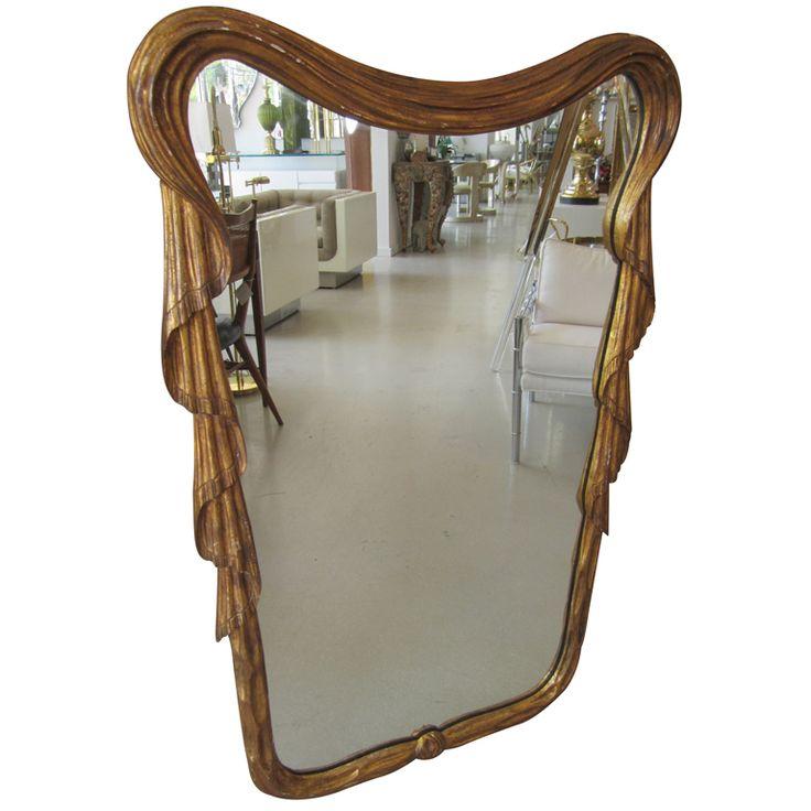 Éste es un especho maniobrado con el borde superior en forma de tienda, en madera dura similar al ébano para el dormitorio.