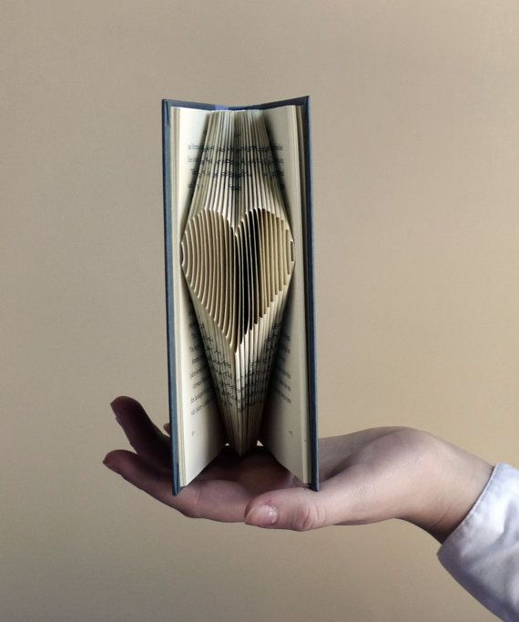 This unique folded paper heart is carefully made from a recycled book. Looks beautiful resting on a bookcase, dresser or mantel. A perfect gift