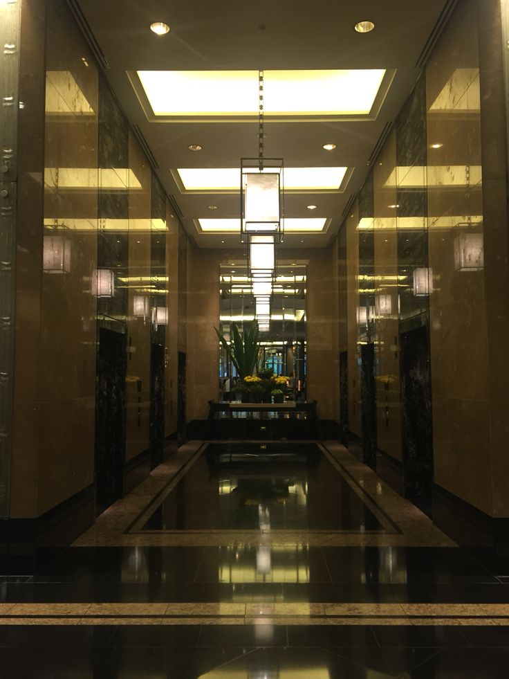 CROWN TOWERS 3: This photo is of the lift area. The walls and floors are covered in marble tiles. It adds glamour to the space. It's quite grand and beautiful.