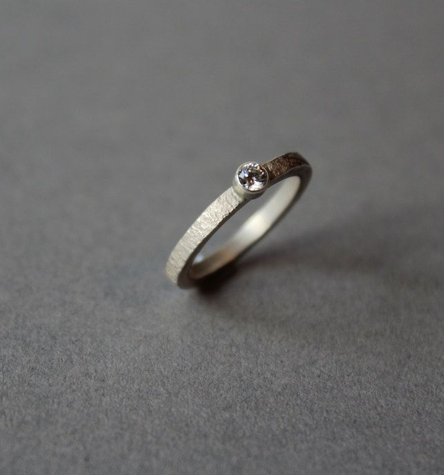 Silver hammered band with moissanite