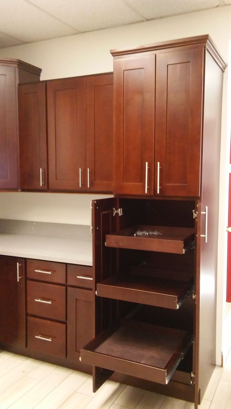 Glass cabinets set in a largely bamboo dominated kitchen - Full Extension Pull Out Shelves In Chocolate Shaker Cabinets Www Wholesalecabinetcenter Com