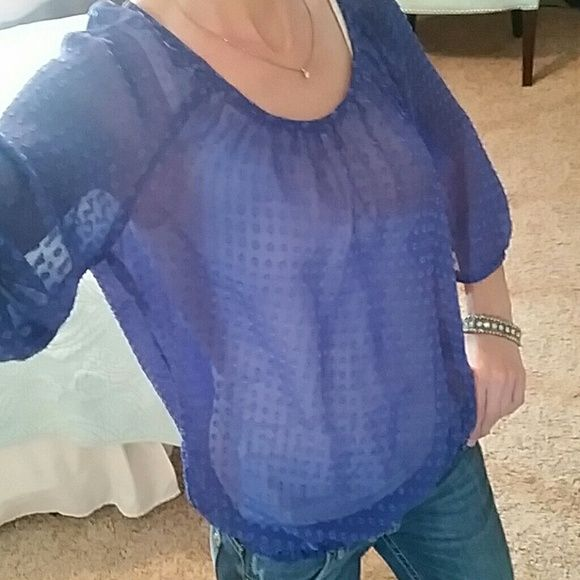"""ANN TAYLOR LOFT XS SHEER PURPLE TOP Ann Taylor Loft sheer, purple, top with textured circles. This top has 3/4 length sleeves and a smocked hem. Can be dressed up for career wear or down with jeans.  Size XS  Armpit to armpit it measures 20"""" across laying flat  Shoulder to hem it measures 23"""" Excellent used condition Ann Taylor  Loft  Tops Blouses"""