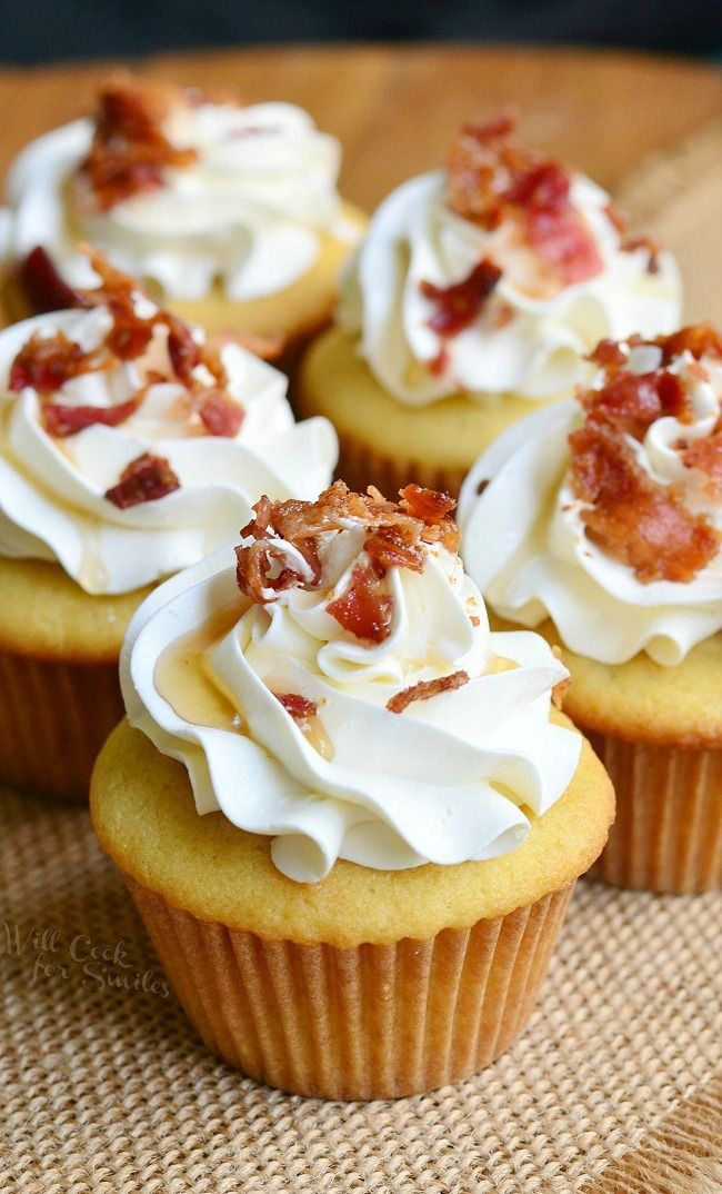 Extraordinary sweet and salty treat. Soft maple cupcakes with a hint of bacon topped with maple buttercream frosting, crispy bacon bits and a touch of maple syrup.
