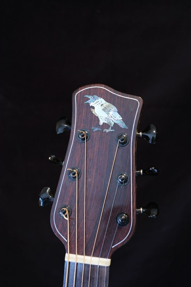 Peg head with mother of pearl inlay of a raven. Silver wire details.