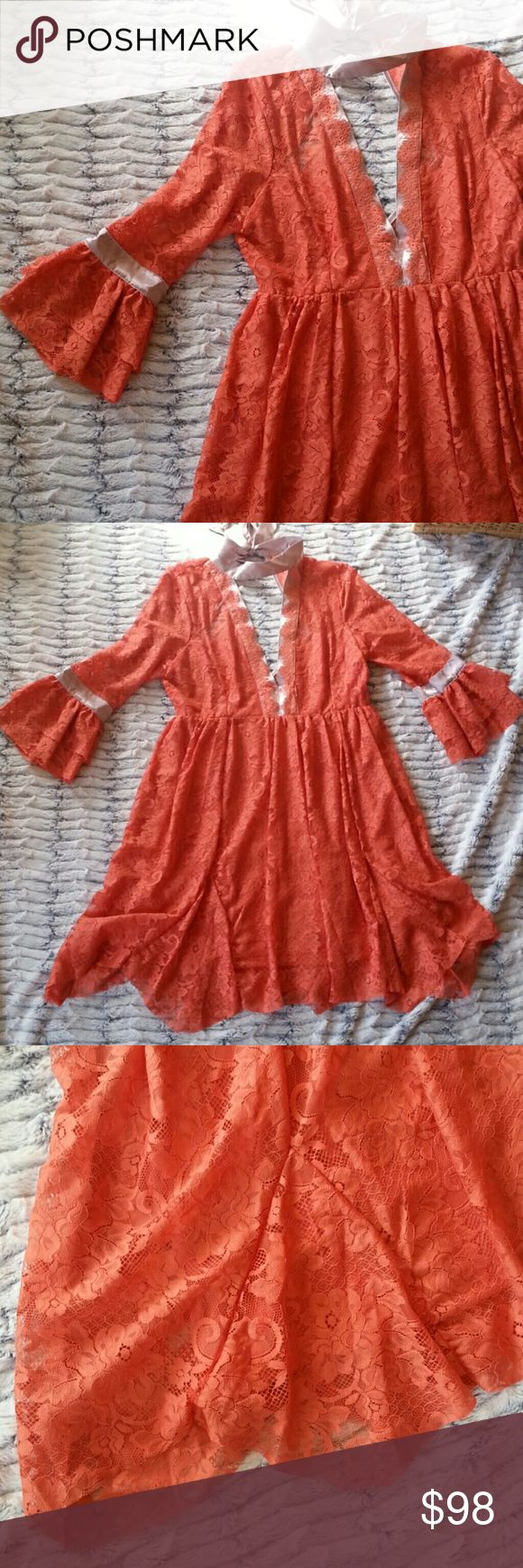 Free People Peach Lace Dress Never worn. Brand new condition. So elegant and lovely. Wide mouthed sleeves. Tie at back of choker neck. Open back. Free People Dresses Long Sleeve