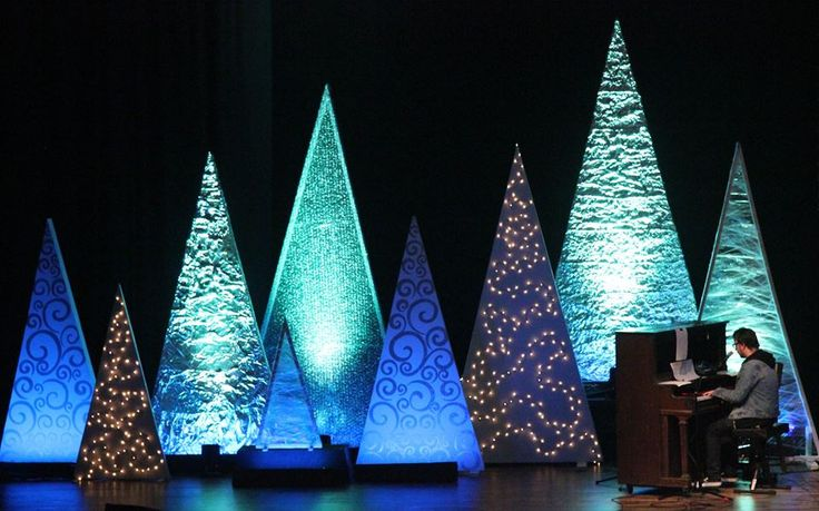 Tiffany Marshall from Gateway Community Church in Webster, TX brings us this cool variety of Christmas trees. Their set consisted of 20 triangular Christmas Trees. 4 - 12'X6' : made with 2X4's 6 - 10'X5' : made with 2X4's 4 - 8'X4' : made with 2X4's 2 - 6'X3' : made with 2X2's 4 - 4'X2' : make with 2X2's They painted the frames white and added bases to the bottom. They used materials such as Saran Wrap/Aluminum Foil/Bubble Wrap/Christmas lights/and painted silver stencil with uplighting to…