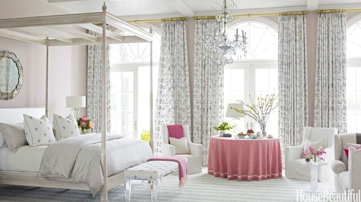 """Who wouldn't want to wake up in this soft and dreamy space? The master bedroom in a Florida house is """"soft, subtle, and refined,"""" designer Marshall Watson says. """"It invites light, air, and the silvery reflections from the water."""" The focal point is the Lancaster bed from his Continental collection for Edward Ferrell   Lewis Mittman, inspired by the architecture of Georgian buildings he had seen in London."""