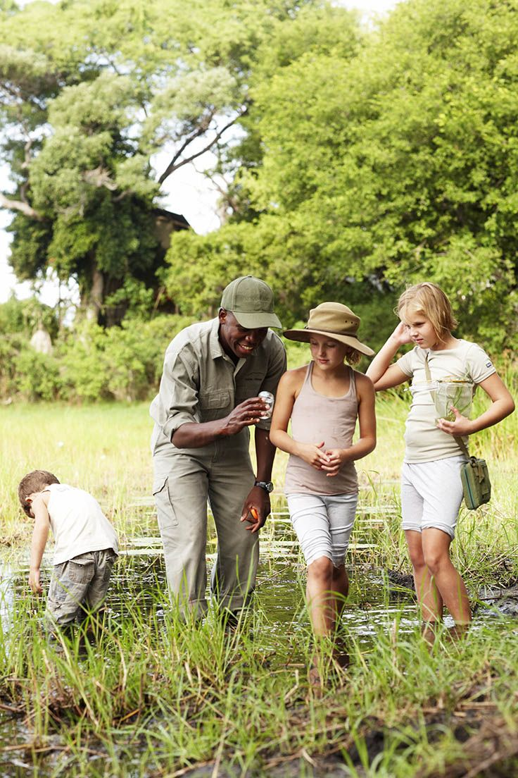 10 Family Vacation Ideas | Botswana. Children discovering African wildlife while on safari. Photo by Mickey Hoyle, courtesy of Wilderness Safaris.