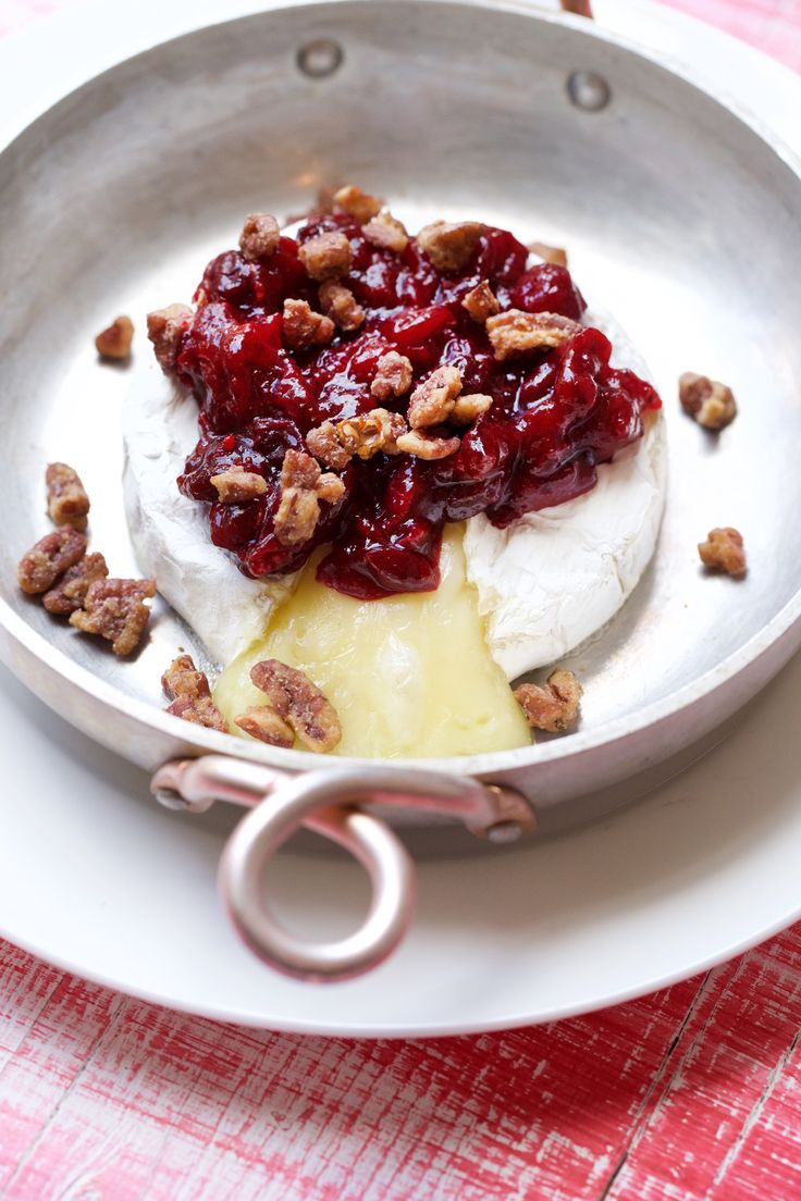 Baked Brie with Cranberry Sauce is a delicious way to use up that leftover cranberry sauce! Get this & more NEW #Thanksgiving leftover recipes when you download out e-cookbook! @marlameridith