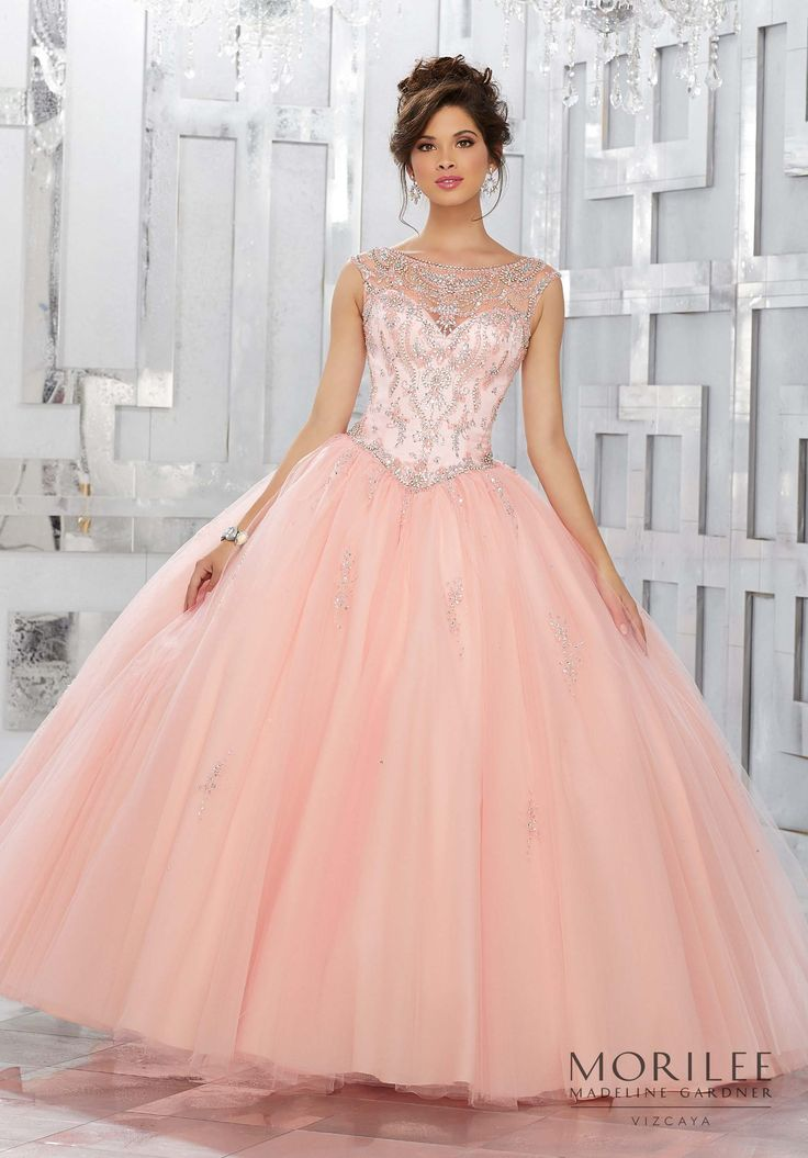 Blush This Classic Quinceañera Ball gown Perfectly Combines a Stunning Illusion Jewel Neckline and Beaded Bodice, with a Princess Full Ball gown Skirt Accented with Delicate Beading. Matching Stole Included. Colors Available: Champagne/Light Purple, Blush, Fuchsia, White. Sweet 15 Dress by Vizcaya | Morilee by Madeline Gardner. Style 89150.