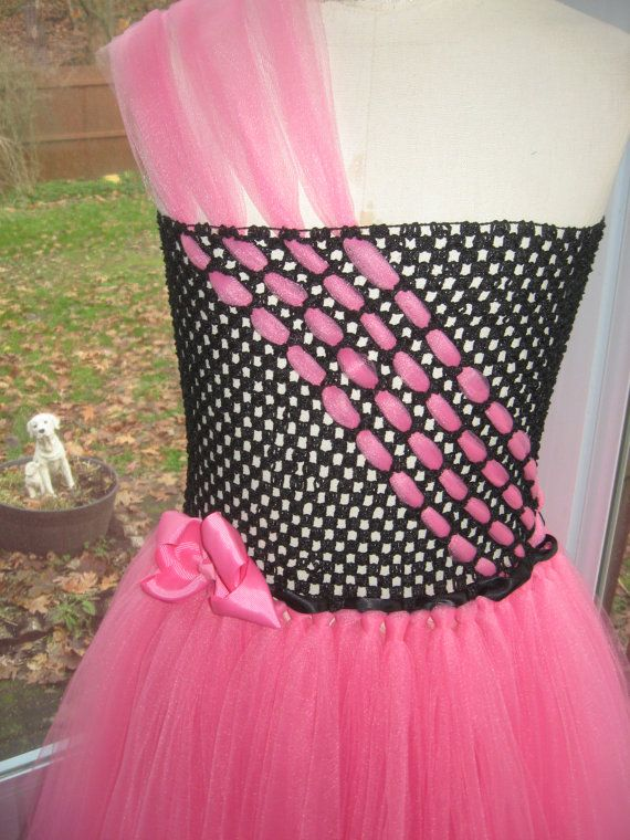 Handmade, tutu, dress, with, black, crochet, top, trimmed with, black, ribbon, hot pink, tulle, and, pink, bow, skirt, is,made with, hot pink, tulle, chest measures 24 to26 length 30 Please measure child before ordering.  Bow, is hair, bow, and can be removed.  Hand wash warm water-NO BLEACH Tumble AIR DRY-NO HEAT