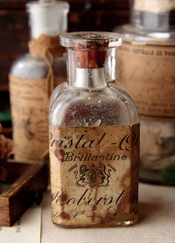 Create old labels for bottles that we dirty up and make look old. Don't use the cheesy ones, go into a site like the Graphic Fairy and pull authentic labels
