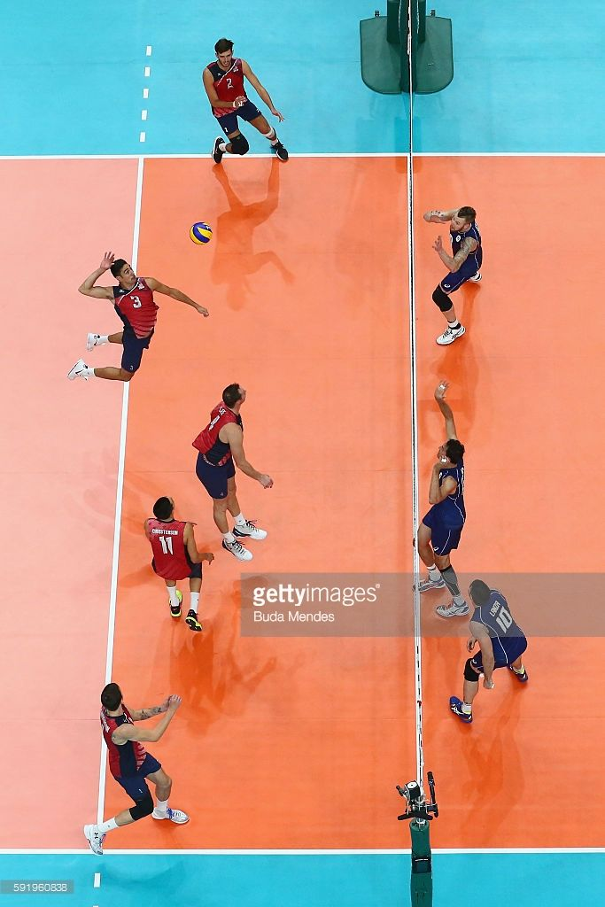 Taylor Sander of United States spikes the ball against Italy during the Men's Volleyball Semifinal match on Day 14 of the Rio 2016 Olympic Games at the Maracanazinho on August 19, 2016 in Rio de Janeiro, Brazil.