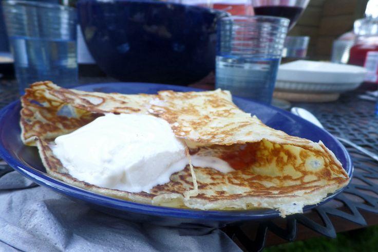 Finnish crepes 'muurinpohjalettu' with strawberry jam and vanilla ice cream