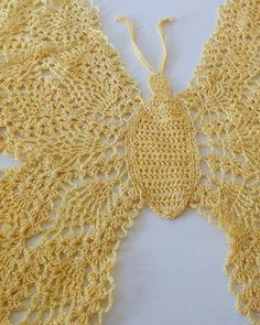 """Watch the Beautiful Butterfly Doily Pattern product review video! An Original Design By: Maggie Weldon Intermediate Skill Size: 21"""" wide x 18"""" tall Materials: Size 10 Crochet Cotton Thread: Yellow – 3"""